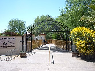 Alameda Park Zoo - Entrance gate and entrance bridge over the duck pond