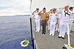 An official party salutes during a wreath ceremony during a sunrise Battle of Midway commemoration June 4, 2012, in North Sulawesi, Indonesia, aboard Military Sealift Command hospital ship USNS Mercy (T-AH 19) 120604-N-GW695-002.jpg