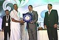 Anand Sharma presenting an award to the Best Exporting Company, at the 19th Indian International Seafood Show 2014, in Chennai. The Minister for Labour & Employment, Fisheries, Rural Development, Goa.jpg