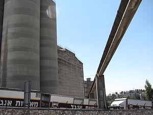 Angel Bakeries - Overhead view of flour pipeline, with silos at left and Angel Bakeries trucks parked below.