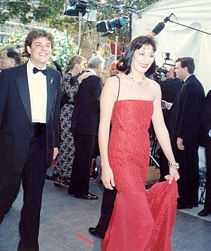 Anjelica Huston - Huston with her half-brother Danny Huston on the red carpet at the 62nd Annual Academy Awards, March 26, 1990