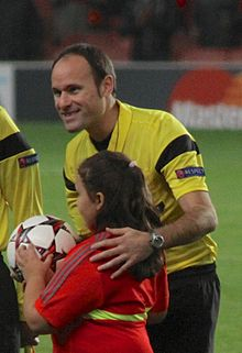 Antonio Mateu Lahoz - ARS-OM 1314 Referees line up with mascot.jpg
