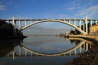 Arrábida Bridge - The symmetrical bridge as seen from the Douro River