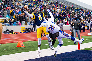 Texas A&M–Commerce Lions football - Vernon Johnson catching a pass against the Angelo State Rams