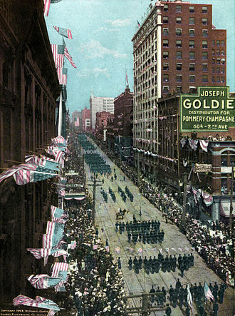 Asahel Curtis - A 1908 parade in Seattle, tinted photograph by Asahel Curtis.