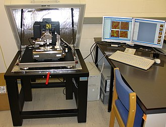 Atomic force microscopy - An atomic force microscope on the left with controlling computer on the right.