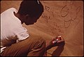 """August Brings the """"D'aug Days"""" to Fountain Square. """"D'aug Days"""" Is a Month Long Festival of Arts Presented to, for, and Sometimes by, the People. Boy Writes on a Wall Especially Provided for Graffiti 08-1973 (3887095107).jpg"""