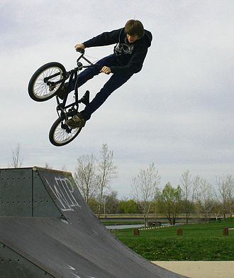 Skatepark - BMX rider getting air off of a Quarter pipe