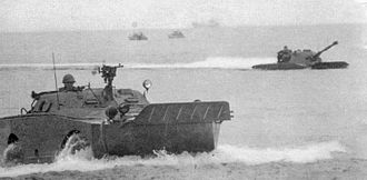 BRDM-1 - A swimming Polish BRDM-1 and PT-76 light tank during an amphibious exercise. Notice the raised trim board in the front of the vehicle.
