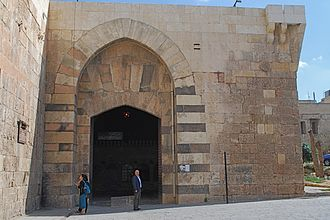 The old walls of Aleppo and the Gate of Qinnasrin restored in 1256 by An-Nasir Yusuf Bab Qinnasrin2010.jpg