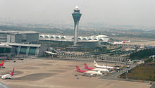 Guangzhou Baiyun International Airport control tower seeing from a takeoff