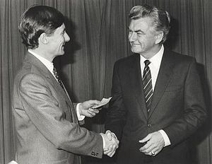 Bob Hawke - Hawke presenting a relief cheque to John Bannon, Premier of South Australia, in April 1983, in the aftermath of the Ash Wednesday fires.