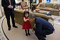 Barack Obama bends down to listen to the daughter of a departing U.S. Secret Service agent, 2013.jpg