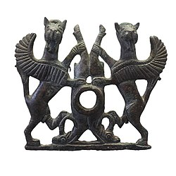 Bit plaque with two winged lions seizing ibexes