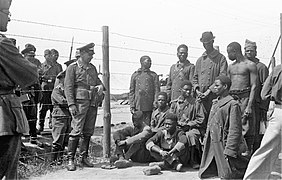 Black prisoners in Eastern Europe; with Luftwaffe soldiers.jpg