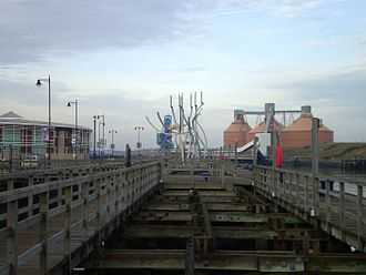 Blyth, Northumberland - A view of the Quayside showing the Spirit of the Staithes sculpture. To the right are the Alcan silos at North Blyth.