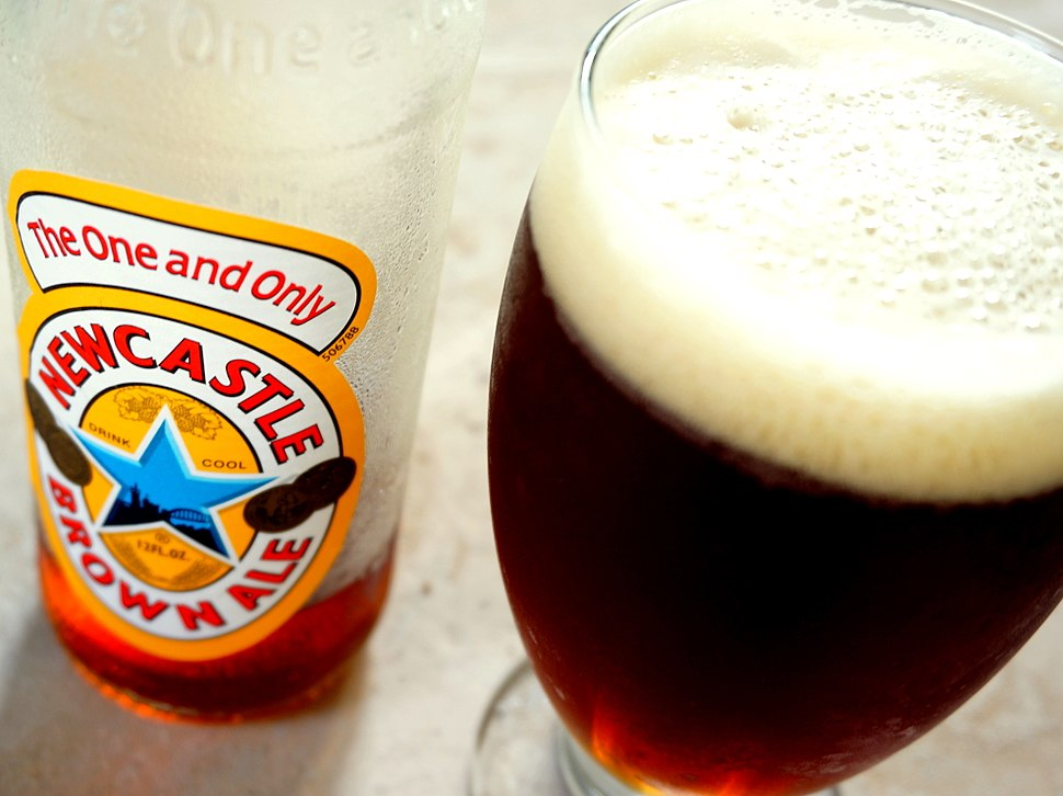 Bottle of Newcastle Brown Ale poured (4by3)