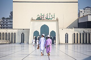 Boys walking towards Baitul Mukarram.jpg