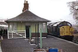 Bridge of Orchy Station two Class 37 with four coaches.jpg