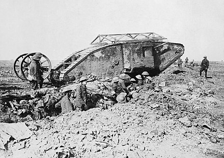 British First World War Mark I tank; the guidance wheels behind the main body were later scrapped as unnecessary. Armoured vehicles of the era required considerable infantry and artillery support. (Photo by Ernest Brooks) British Mark I male tank Somme 25 September 1916.jpg