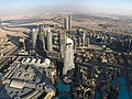 Building into the desert, a view from the Burj Khalifa (48612018518).jpg