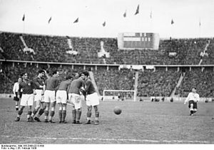 Paul Janes - Janes (r.) scores against Yugoslavia in 1939