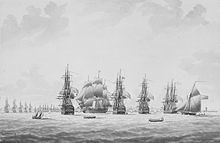 Print of Five sailing ships, four seen stern on, and the fifth from the side. A town and coastline in the background, with a line of distant ships in front of it.