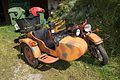 Camouflaged motorcycle with sidecar (23381644490).jpg