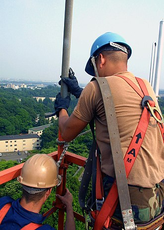 Camp Zama - Two U.S. airmen work atop a signal tower at Camp Zama in June 2002.