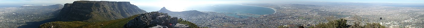 A 360° panorama of the Cape Town surrounds as seen from Devil's Peak. Table Mountain is obvious, occupying a large portion of the view. The edges of the panorama point approximately southeast.