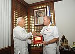 Capt. Greg Fenton, commanding officer of the aircraft carrier USS George Washington (CVN 73) receives a key to the city from Manila, Republic of the Philippines Mayor, Alfredo S. Lim.jpg