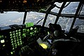Capt. Yuri Batten looks at a map 19 while flying on a C-130H Hercules (19 March 2011).jpg