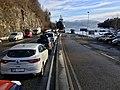 Cars in line for ferry line at Hatvik (Hattvik), Os Municipality, over Fusafjorden (Eikelandsfjorden) to Venjaneset, Fusa, Hordaland, Norway. Poto taken on morning of 2018-03-20.jpg