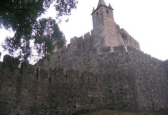 Portuguese Gothic architecture - View of Santa Maria da Feira Castle. The Keep is unique in the world with its four pinnacles of four towers stuck in the main tower.