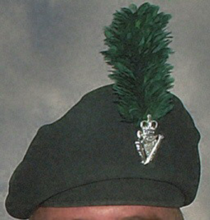 Caubeen - A British army caubeen with a cap badge and green hackle