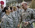 Chairman of the Joint Chiefs of Staff U.S. Army Gen. Martin E. Dempsey, right, talks with Air Force Airman 1st Class Oliva Ruiz, with the 374th Medical Support Squadron, after an all call at Yokota Air Base 130425-F-PM645-418.jpg