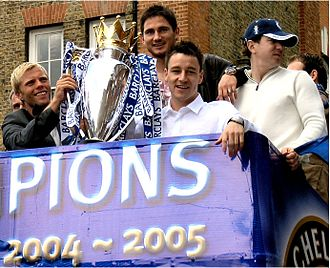 John Terry - Terry (right of trophy) celebrates winning the 2004–05 Premier League with Chelsea