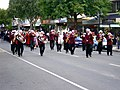 Charles Sturt University Town and Gown academic procession down Baylis Street, lead by the Riverina Concert Band.jpg