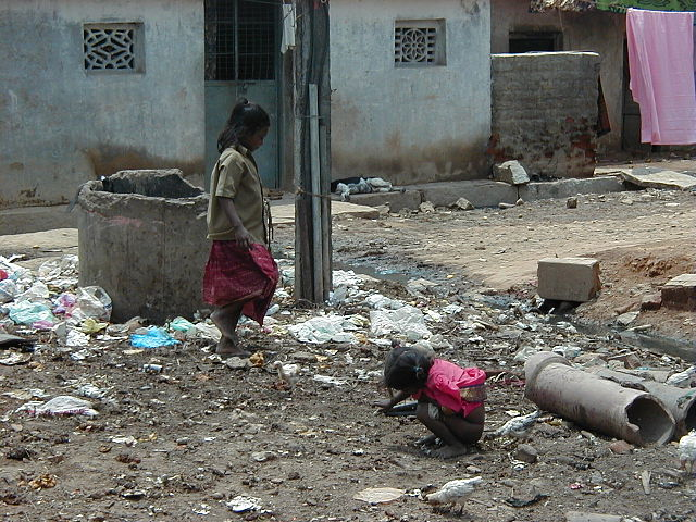From commons.wikimedia.org: Children in unsanitary conditions in slum in India {MID-181095}