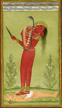 A decapitated, nude, red-complexioned woman stands on a man lying on the ground. She holds in her left hand her severed hand that drinks the blood jet sprouting from her neck. She holds a knife in her other hand. She wears a serpent across her torso and various gold and pearl ornaments.