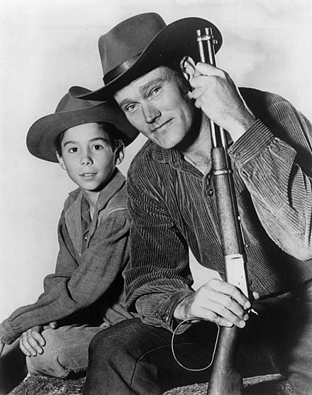 Johnny Crawford and Chuck Connors in The Rifleman (1960) Chuck Connors Johnny Crawford The Rifleman 1960.JPG