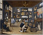 Circle of David Teniers - An artist in his studio surrounded by his paintings.jpg