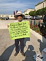 Climate activist at Capitol South Metro in 2019 - Mississippi River flooding 04.jpg