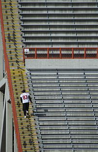 A Calgary Stampeders player climbing the stairs at McMahon Stadium during 2007 training camp.
