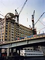 Construction of Credit Suisse buiding, London Docklands, with DLR train, beneath West India Quay Station, E14 c1989.jpg