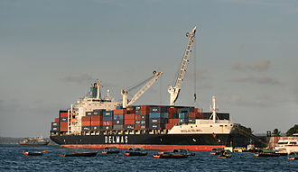 Cargo ship - A Delmas container ship unloading at the Zanzibar port in Tanzania