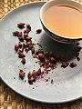Cup of rosebud tea with dried pink rose buds.jpg