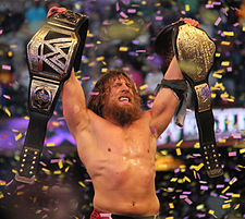 Daniel Bryan celebrating with the WWE World Heavyweight Champion after winning it at WrestleMania XXX