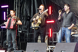 The High Kings - Darren Holden, Finbarr Clancy, and Brian Dunphy perform at a High Kings concert in Donegal, 2011.