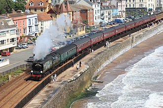 Mainline steam trains in Great Britain - The Royal Duchy train, hauled by Tangmere, along the Dawlish sea wall in 2015